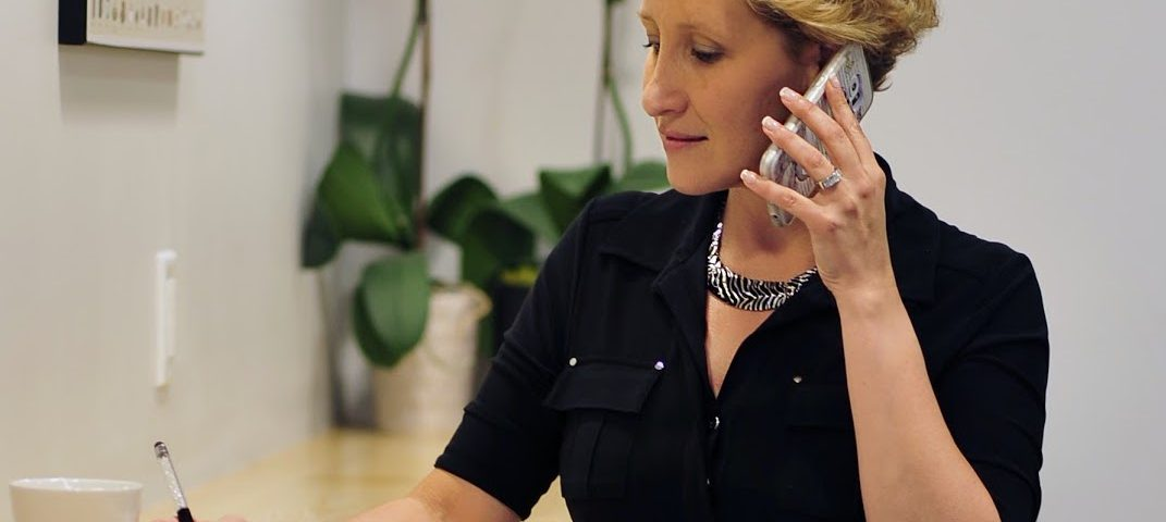 woman making sales call/ grow your concierge business/